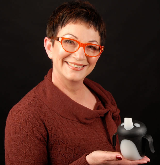 Mandy Haberman holding the Penguin cup on black background